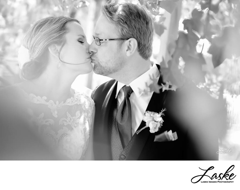 Photographers in OKC shoot Bride and Groom Kiss Closeup