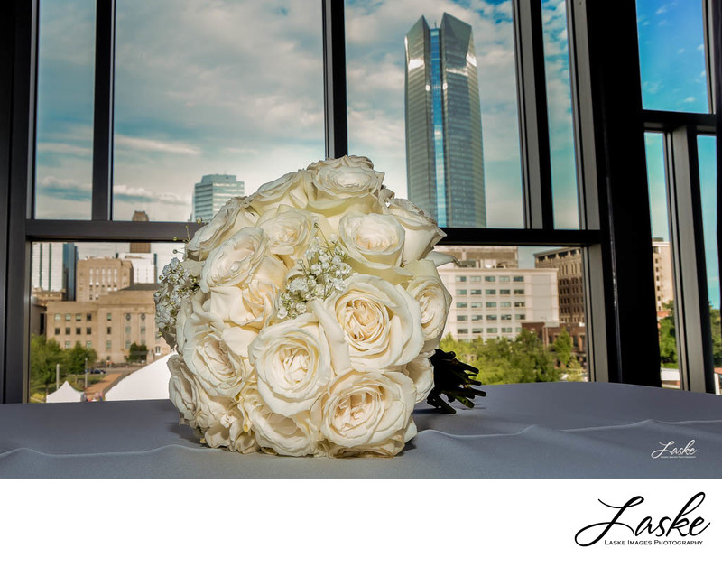 Wedding Bouquet Sits on Reception Table at Civic Center Music
