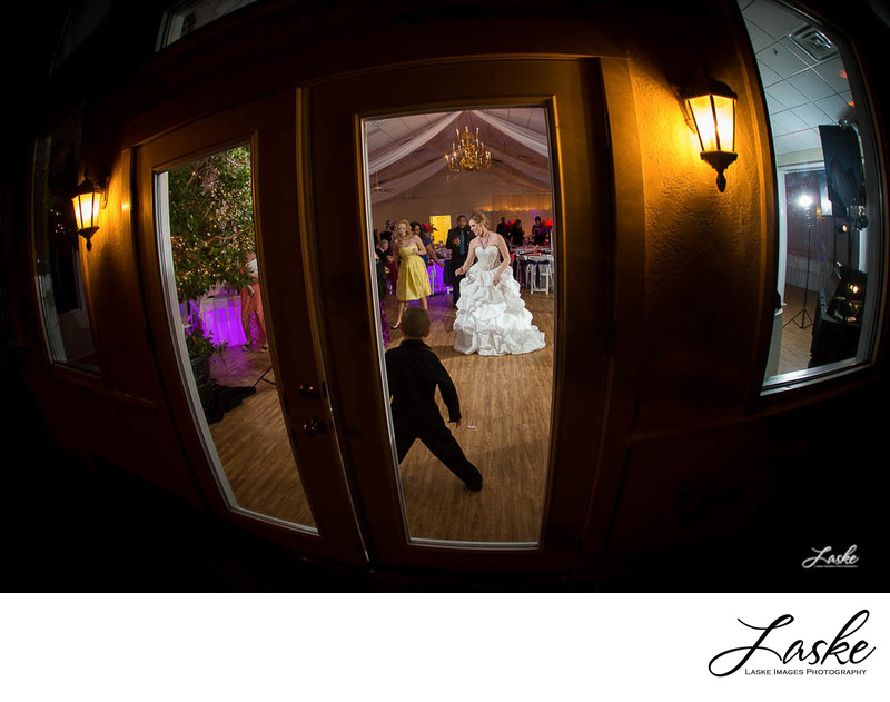 Bride and Wedding Guests Dancing View Through Window