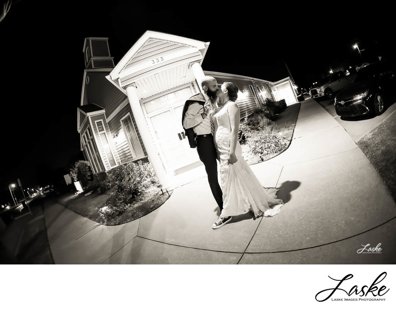 Bride and Groom Kiss Outside Boulevard Chapel in Edmond
