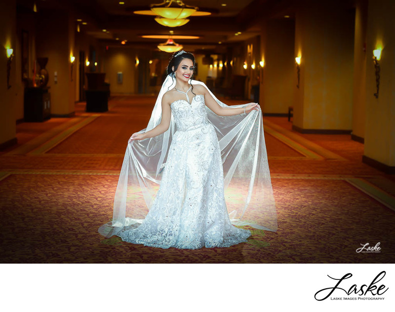 Beautiful backlit portrait of a Bride standing in the Hotel Hallway