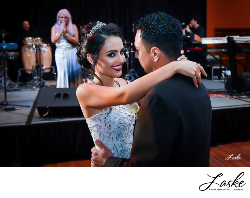 Bride Smiles as she enjoys her first dance with her Groom