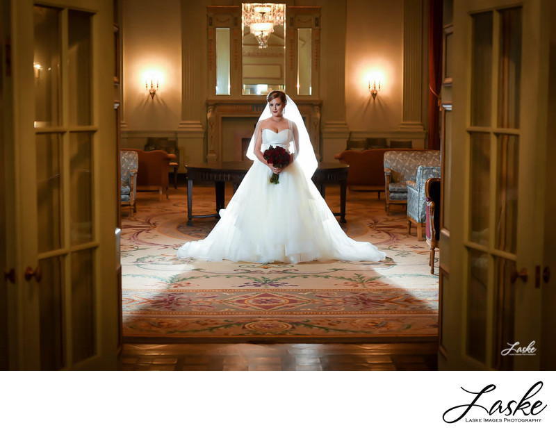 Bridal Portrait Shot through Open Double French Doors