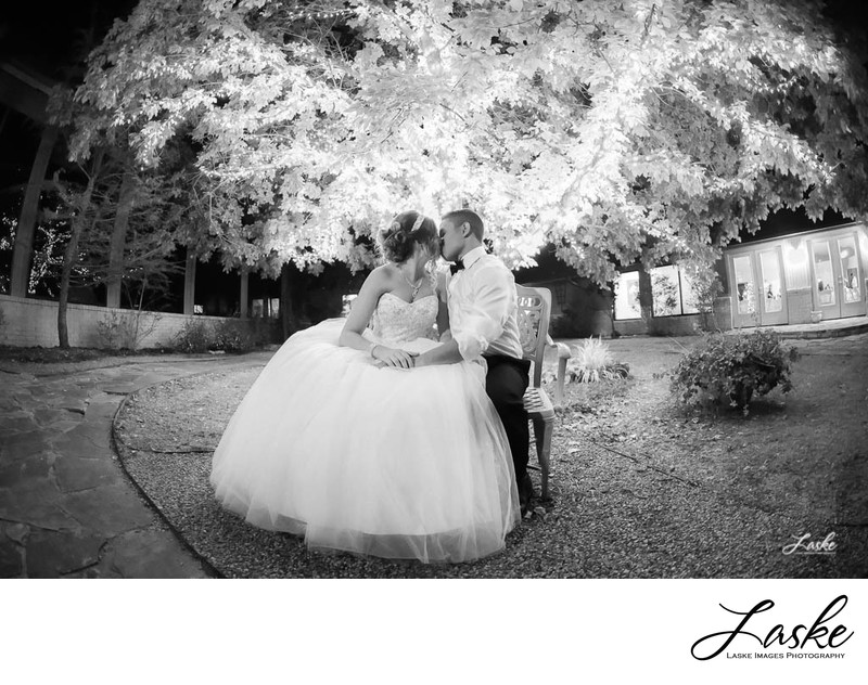 Couple Kisses Under Tree at Thunderbird Chapel in Norman, Oklahoma