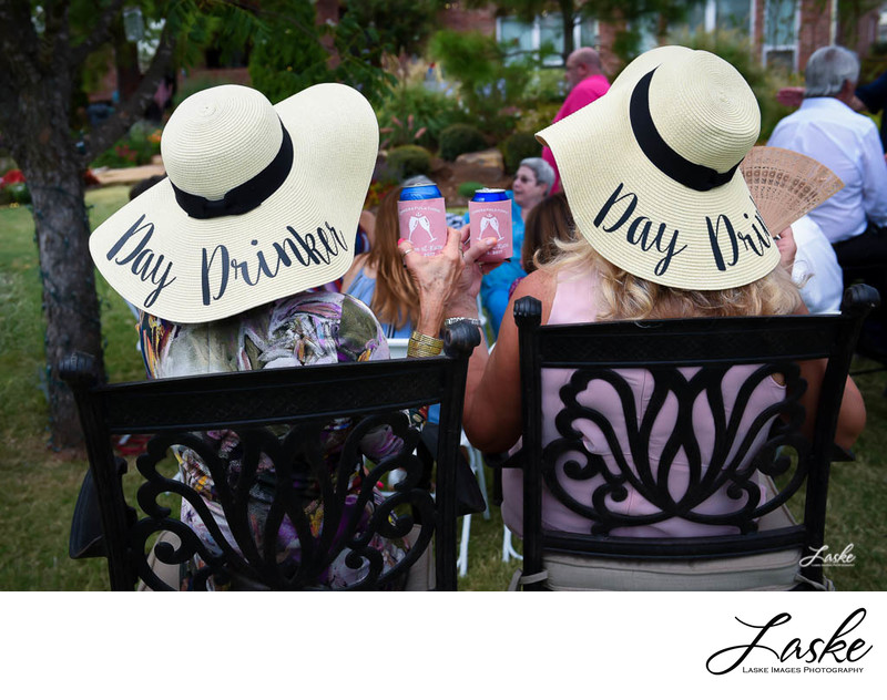 Two Ladies in Hats that Say Day Drinker at Wedding
