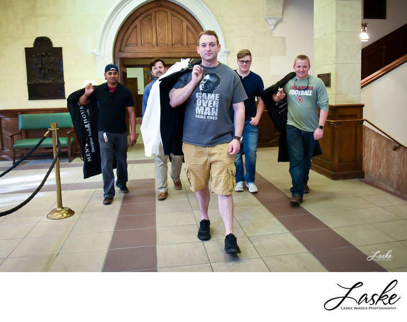 Groom Walks into Church With Groomsmen Behind Him