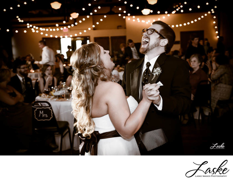 Bride and Groom During First Dance Groom Laughs