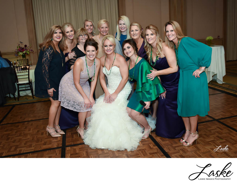 The Bride poses with a group of ladies during wedding reception