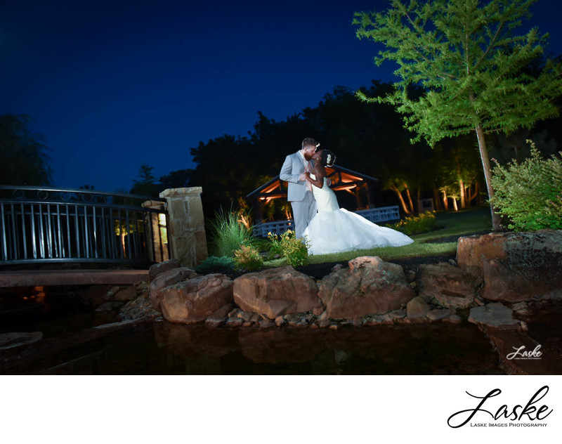 Bride and Groom Kiss in Beautiful Outdoor Setting