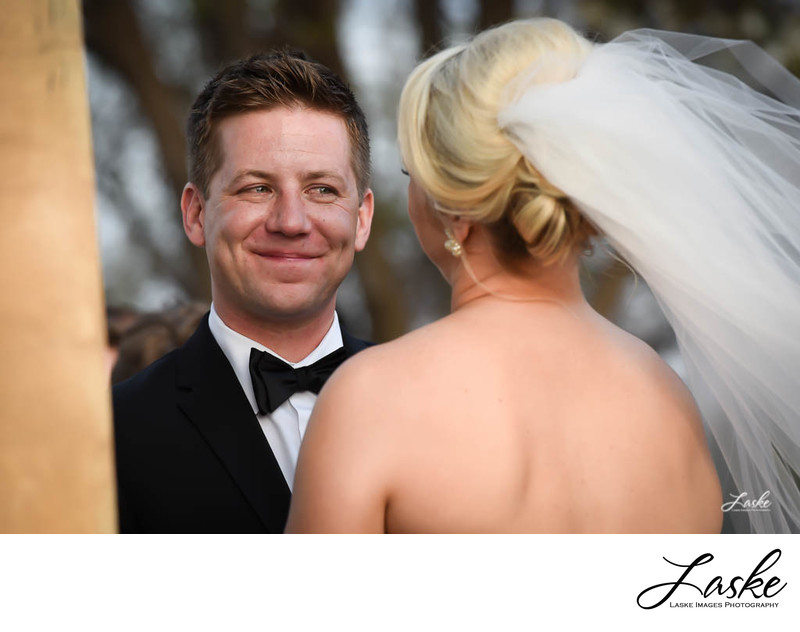 The Groom Has A Huges Smile as He Looks at the Bride