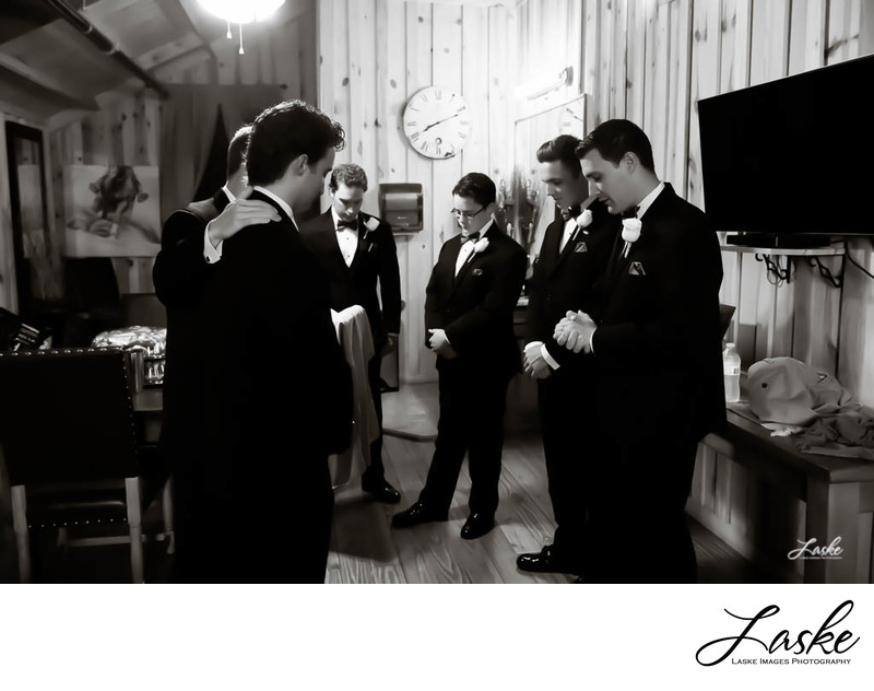 Groom and His Groomsmen Stop to Pray Before the Wedding Ceremony
