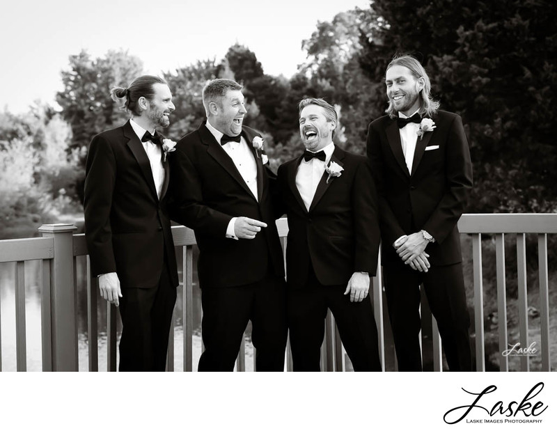 Groom and Groomsemen Laughing on Deck on Wedding Day