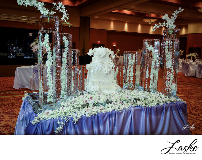 Tall Ice Sculptures Hold Flowers on Cake Table