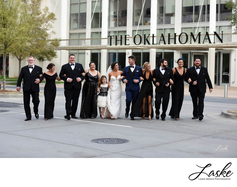 Wedding Party Walks Arm in Arm Across the Street in Oklahoma City