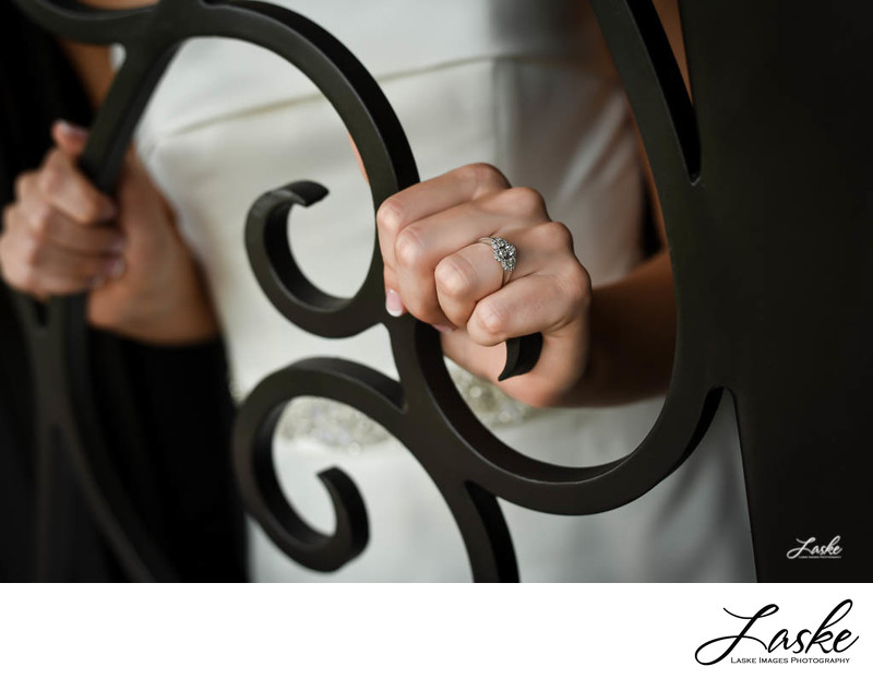 Bride Holds Iron Door Close Up of Wedding Ring