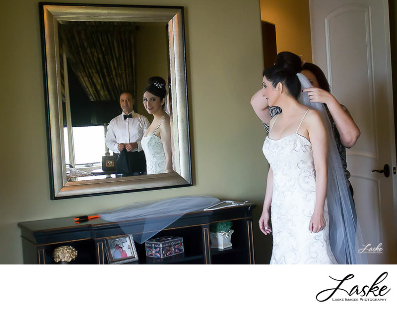 Bride Looks at Groom in Mirror