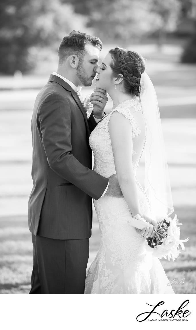 Black and White Wedding Photo of Bride and Groom Almost Kissing