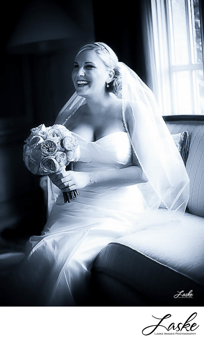 Wedding Photograph of Bride Holding Bouquet in Wedding Dress