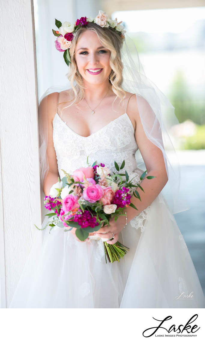 Picture of Bride Holding Bouquet in Outdoor Portrait