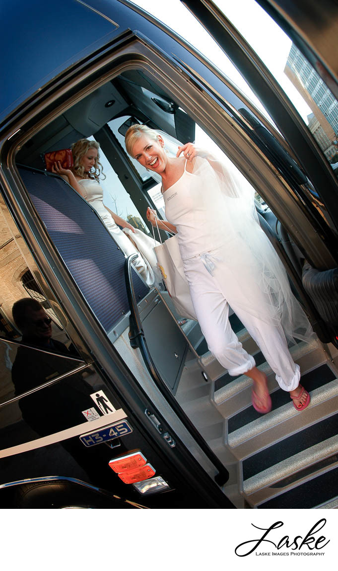 Bride Laughing As She Exits Charter Bus to Get Ready for Wedding