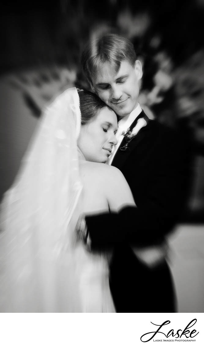 Bride and Groom Hug On Wedding Day