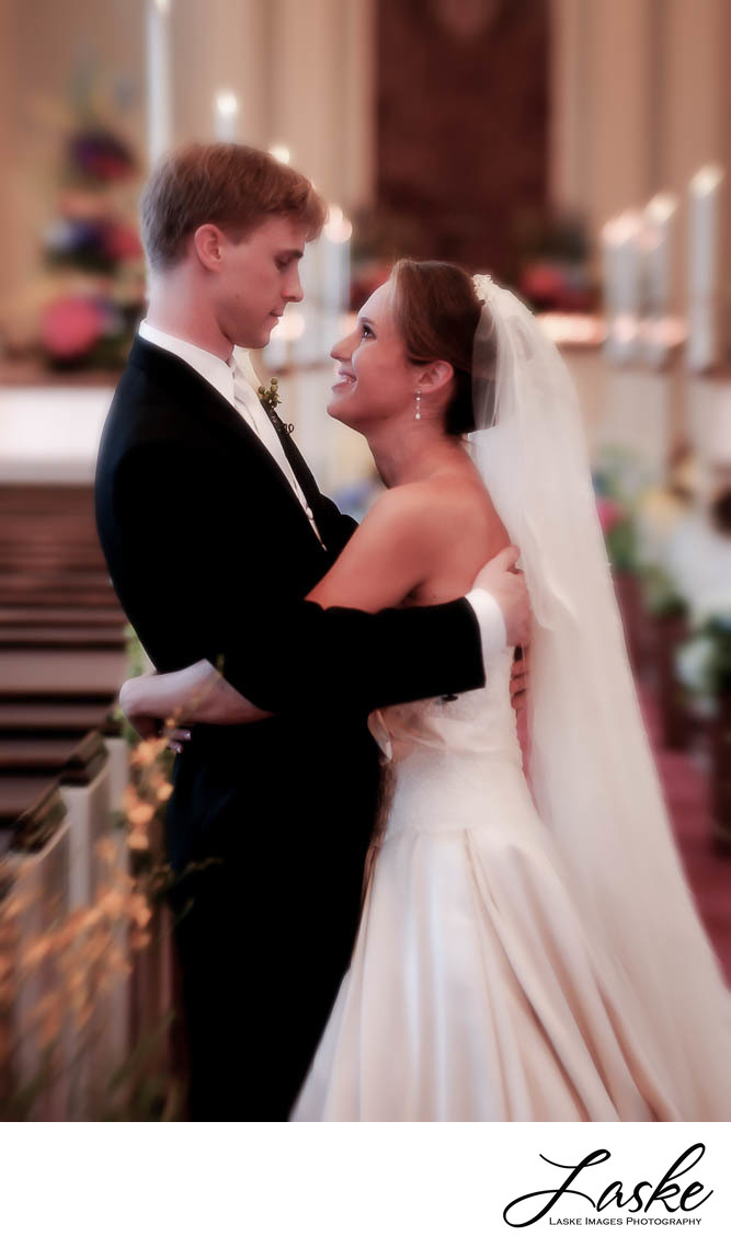 Bride and Groom Look at Each Other in Church