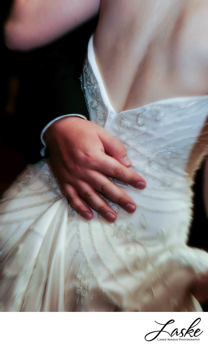 Groom's Hand on the Bride's Back during Their First Dance