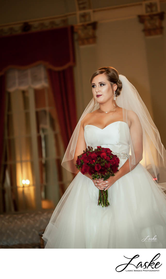 Bride in Dress with Red Rose Bouquet`