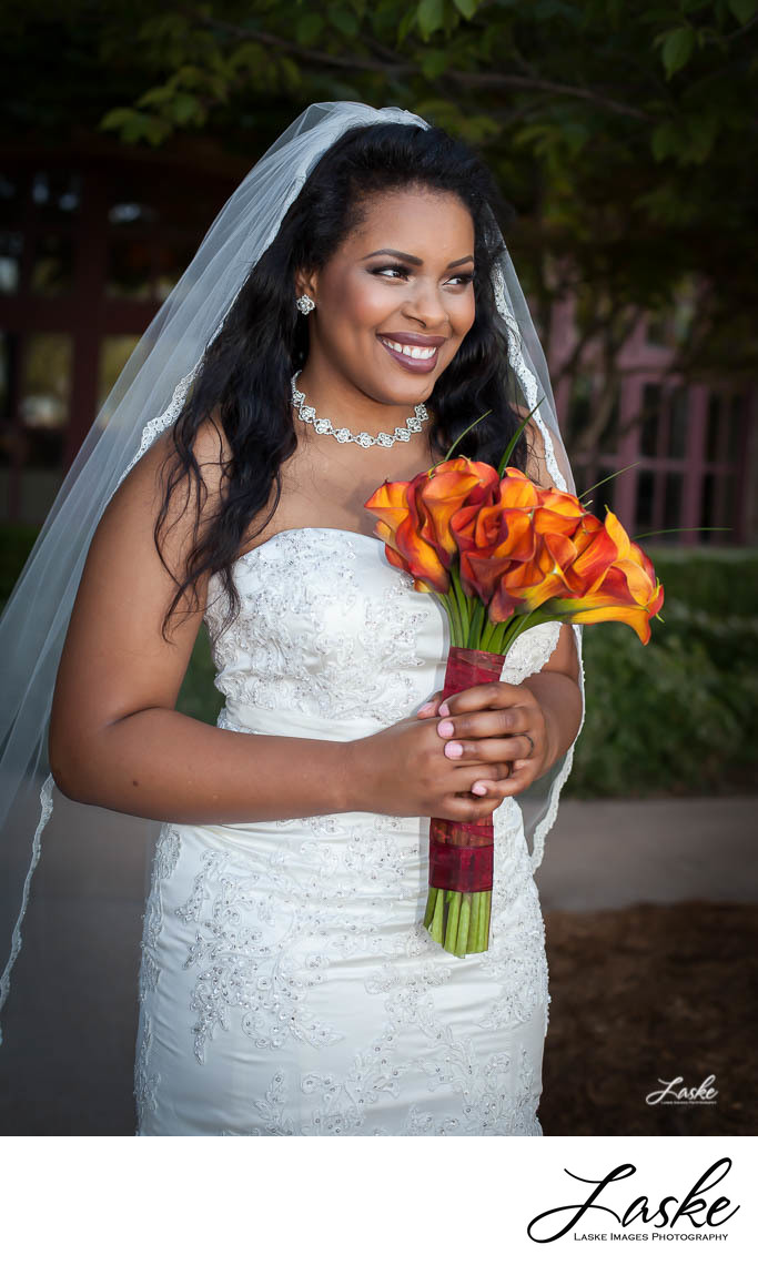 African-American Bride Smiles with Gorgous Orange and Red Wedding Bouquet