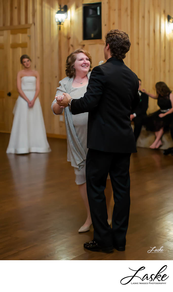 Groom Dances with Mom While Bride Watches