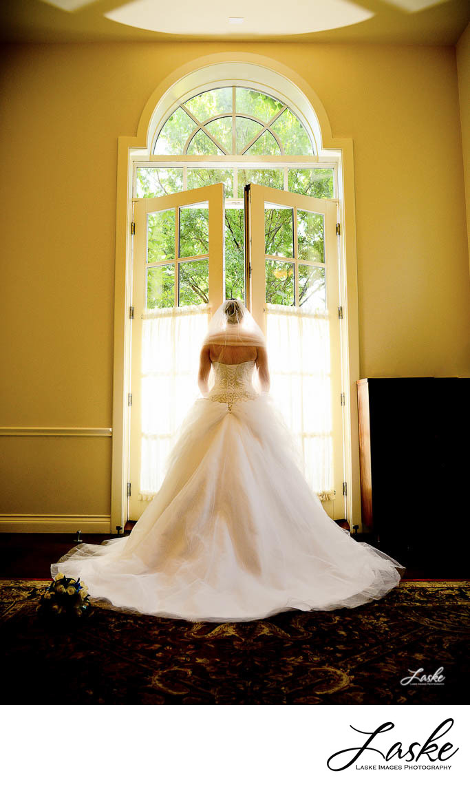Back shot of bride opening doors to make her grand entrace at Dominion House in Guthrie, OK