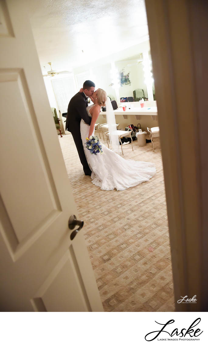 Groom Kisses Bride in the Bridal Suite at Walnut Creek Wedding Chapel