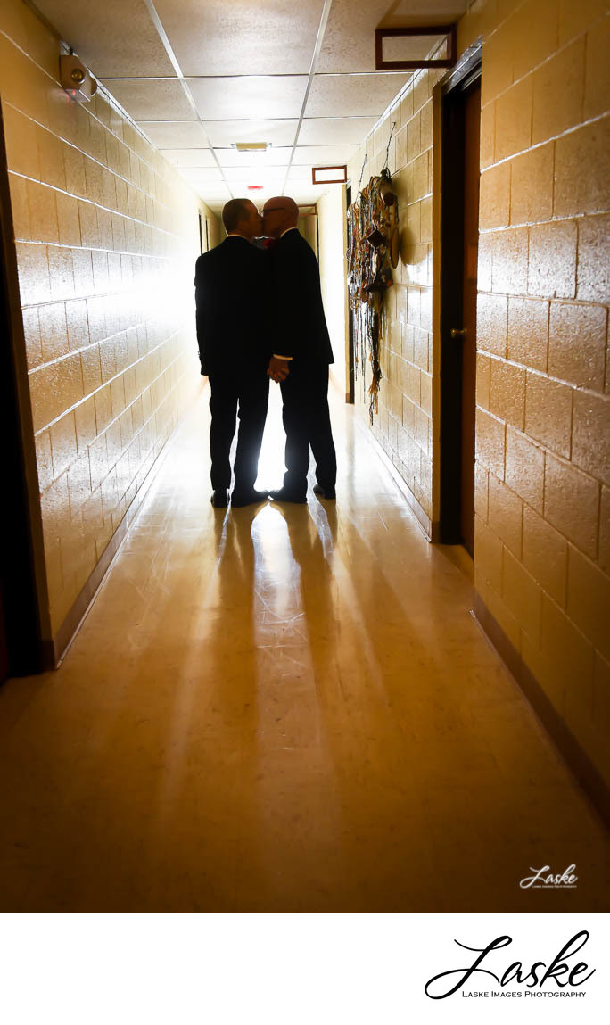 Same Sex Couple Stops to Kiss in the Hallway of the Church