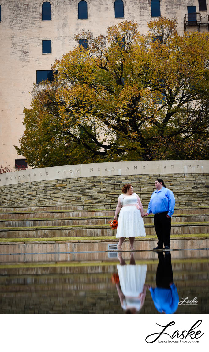 Couple Stands By Reflecting Pool By OKC Bombing Memorial on their Wedding Day