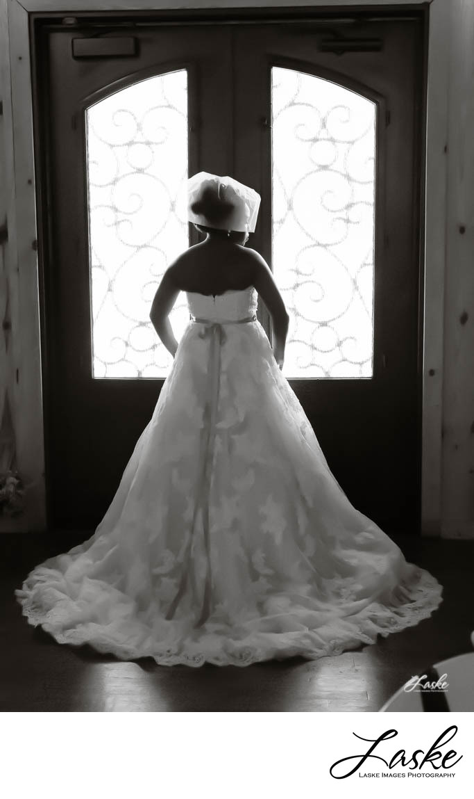 Bridal Portrait of Bride in From of Double Doors