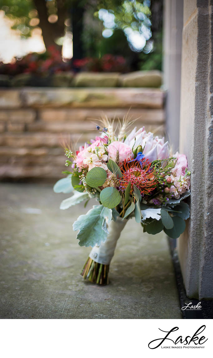 Bride's bouquet leaning against wall