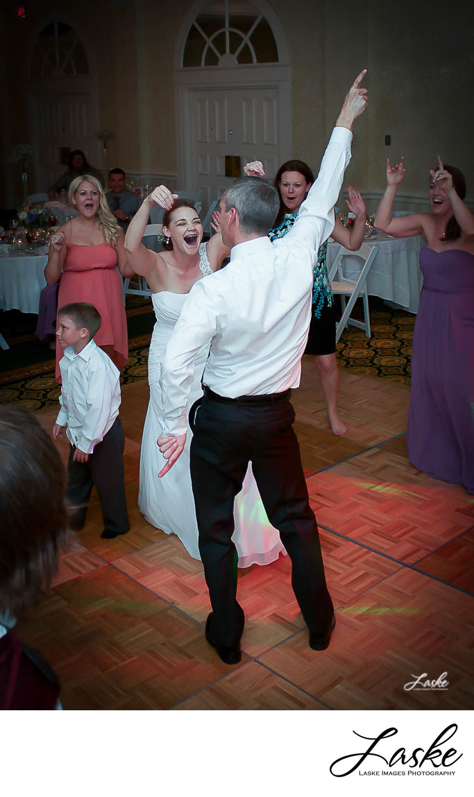 Bride and Groom Dancing and Laughing at Reception