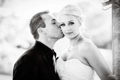 Groom Kisses His Bride on their Wedding Day
