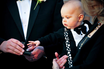 Baby reaches for the Bride's Wedding Ring