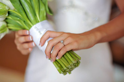Bride Holds Bouquet with Ring Shot