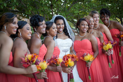 African-American Bride Laughs with Bridesmaids