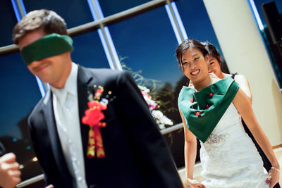 Blindfolded Groom Waits for Smiling Bride During Cultural Wedding Tradition