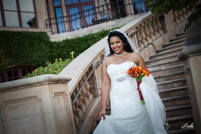 Bride on Stone Stairs at Gaillardia in Oklahoma City.
