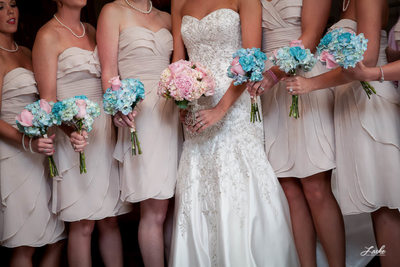 Bride and Bridesmaids Lined Up Showcasing their Bouquets