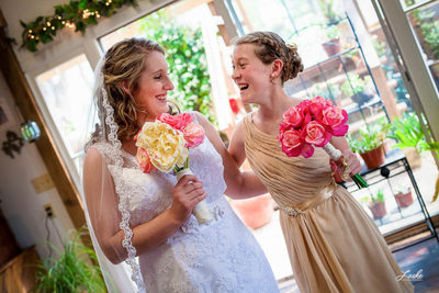 Bride and Flower Girl Laughing