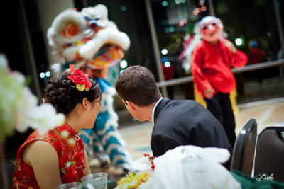 Bride and Groom watch Costumed Dancers During Reception