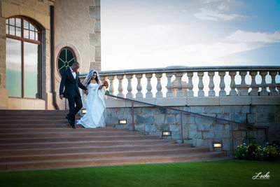 Bride and Groom Walk Down Stone Stairs at Gaillardia Country Club in Oklahoma City