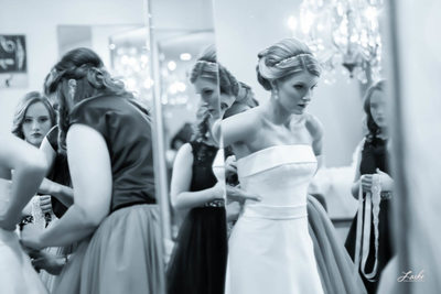 Bride Getting Ready in Front of Mirror on Wedding Day