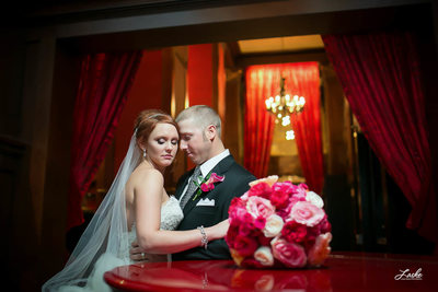 OKC Wedding Photographers take Pic of Bride leans her head against Groom Skirvin Hotel By Grand Piano