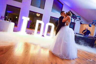 Bride gives Groom a Big Kiss During First Dance